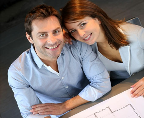 Couple looking at house plans.